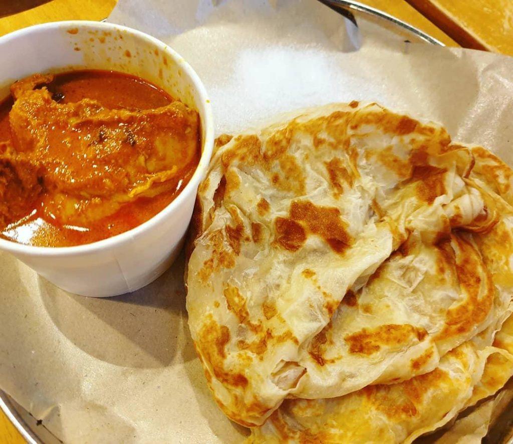 Singapore's crispy flatbread with fish curry called roti prata
